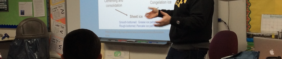 Vincent Domena teaches local students about sea ice. Photo courtesy of Vincent Domena.