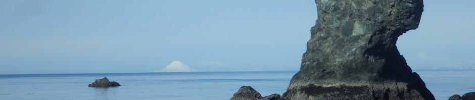 photo of rock, ocean, mountain